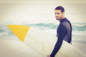 Man with surfboard - Laser Eye Surgery Recovery Time