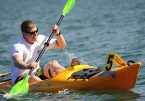 Man in yellow kayak after eye surgery