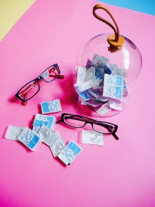 Contact lenses and glasses on table - dangers of contact lenses
