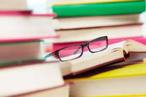 Glasses on books: Laser eye surgery, is it worth it?
