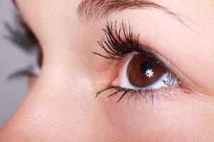 close view of female brown eyes hypermetropia