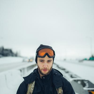 Man walking down highway in winter