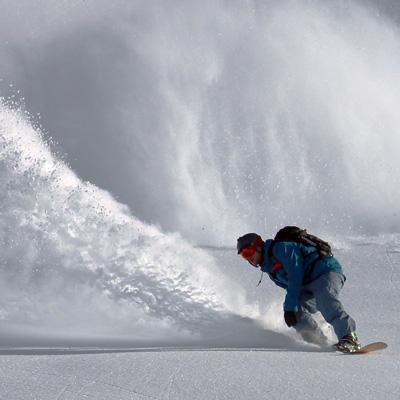 Man snowboarding down a mountain